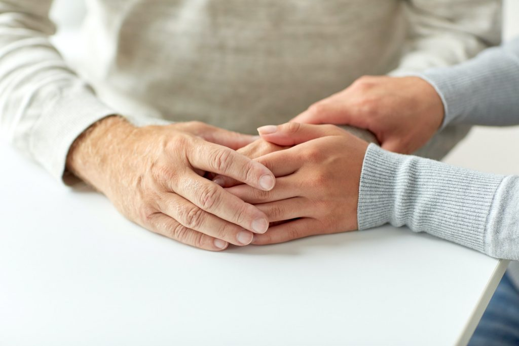 An image of an aged care professional taking care of patient