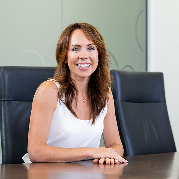 Laura Sutherland of Above and Beyond Group sitting on a meeting room