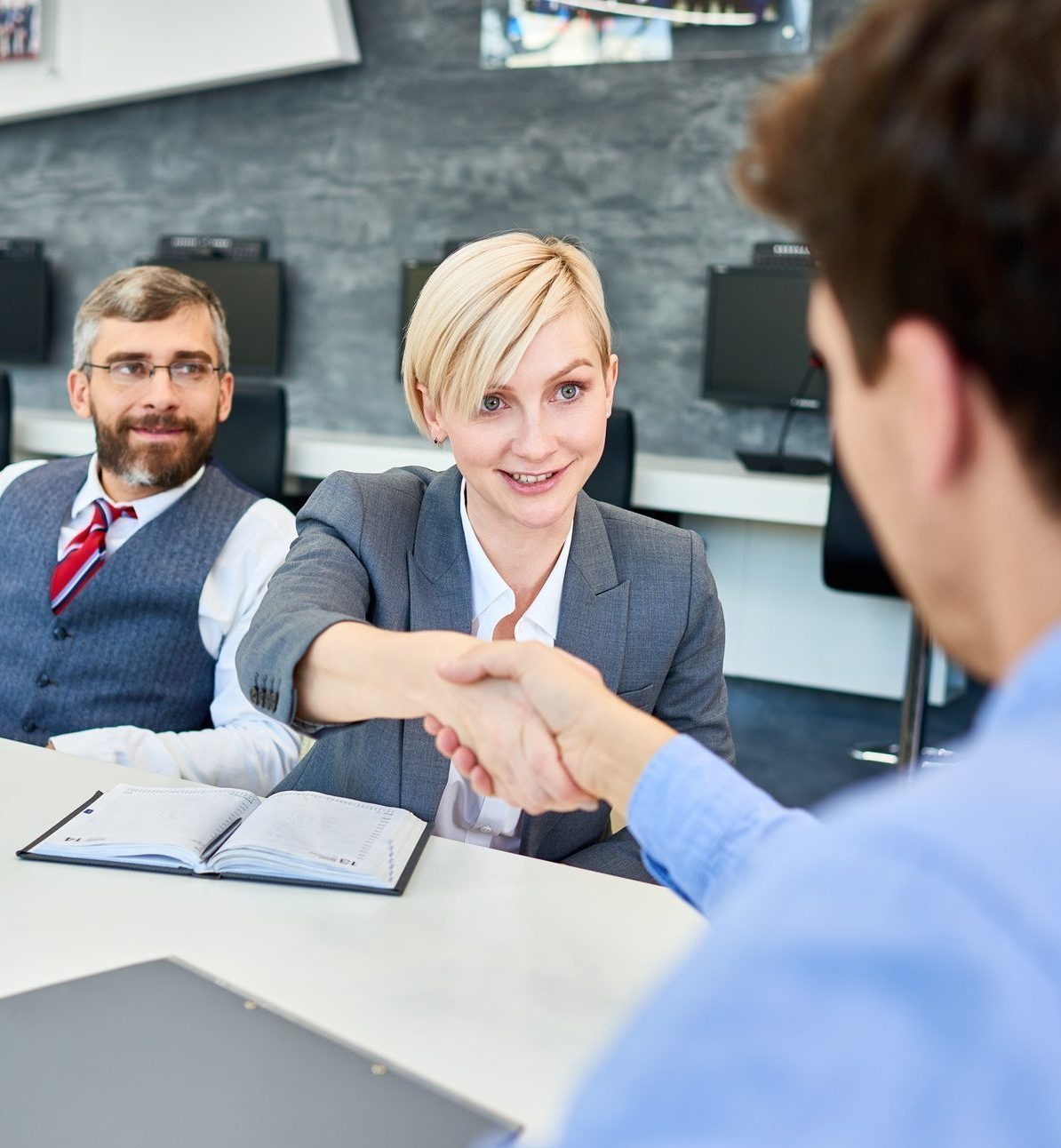Image of hiring manager congratulating an interviewee